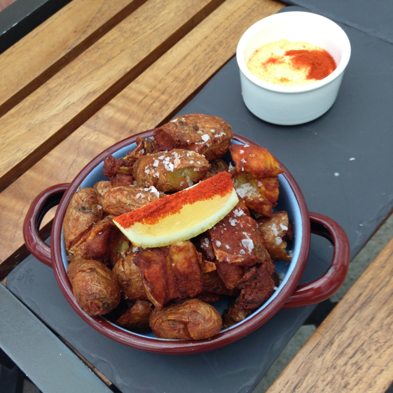 North Arm Farms fingerling Patatas Bravas with spicy calabrian chile aioli.