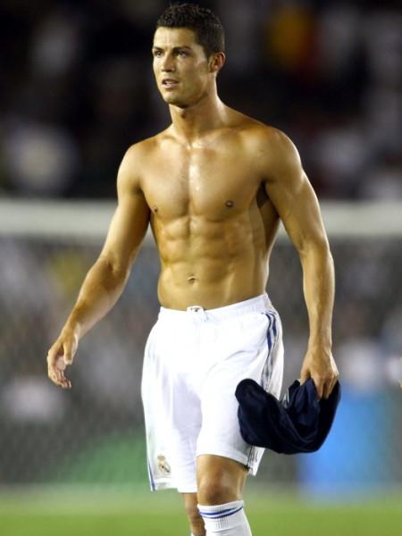 Cristiano Ronaldo removes his Real Madrid soccer jersey in Pasadena, CA.