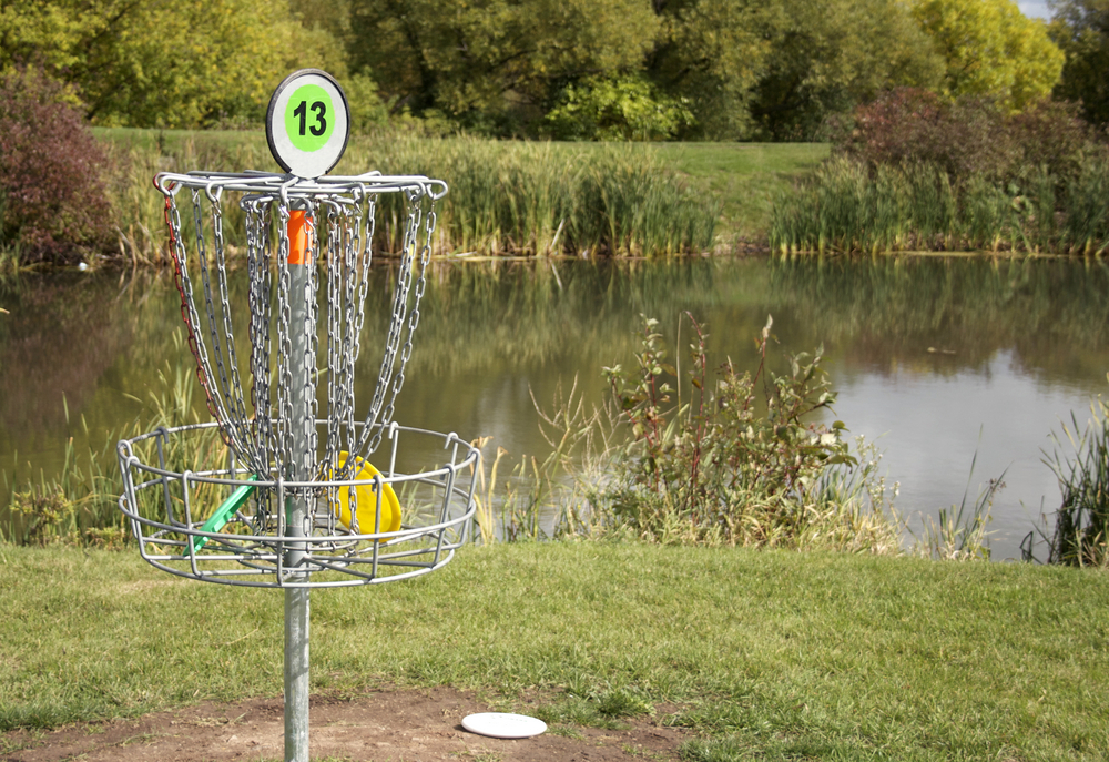 deepspacedave / shutterstock / http://www.shutterstock.com/pic-38738257/stock-photo-a-frisbee-golf-target-with-discs-in-the-basket.html?src=vObf5tK8bDX5DfZSLdjQmw-1-9