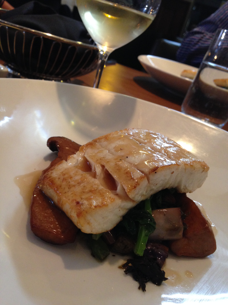Pacific Halibut with king oyster mushrooms braised in abalone sauce, preserved olive, green beans & eggplant with wilted pea greens. (Photo: Laura Lefurgey-Smith)