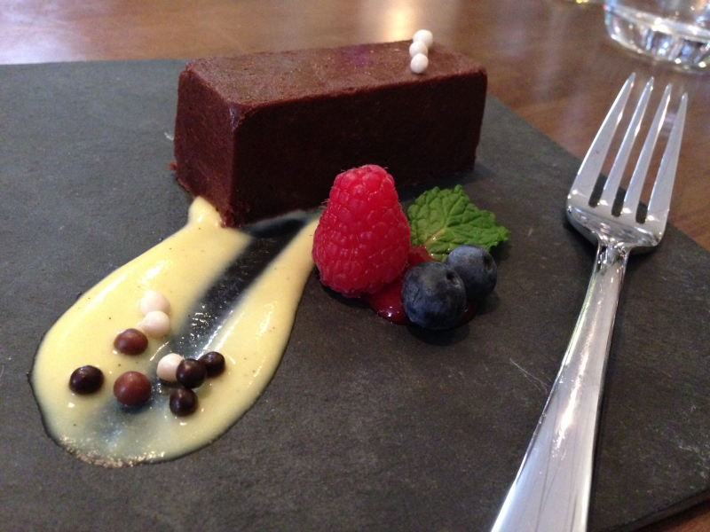 Chocolate Marquise with Irish cream anglaise, chocolate pearls and raspberry coulis. (Photo: Laura Lefurgey-Smith)
