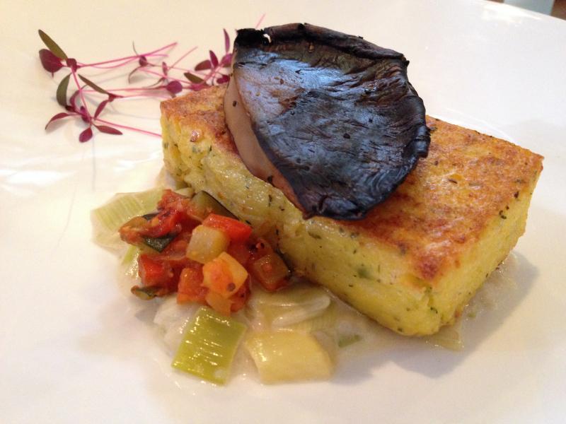 Pan-seared Truffle Polenta with leek fondue, ratatouille, thyme glazed portabella, garlic cream and micro chard. (Photo: Laura Lefurgey-Smith)