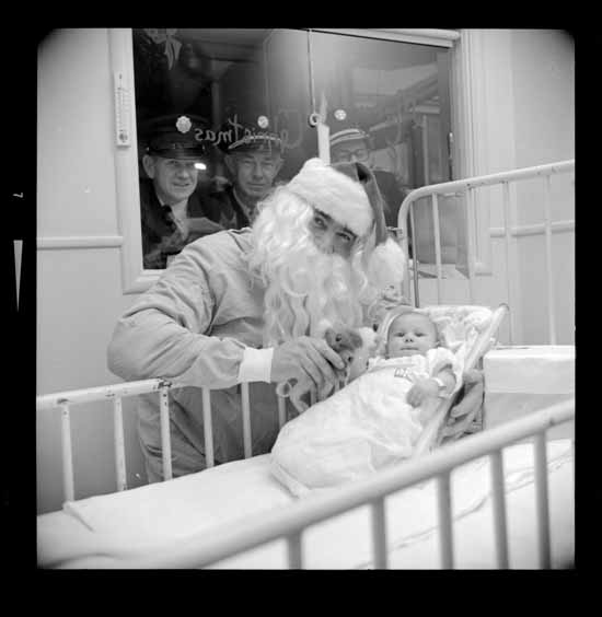 Fireman playing Santa at Children's Hospital, Dec. 16, 1966. Photo via Vancouver Public Library.