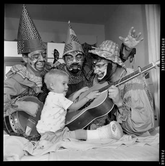 Kiwanis Club clowns Christmas visit at Children's Hospital, Dec. 14, 1965. Photo via Vancouver Public Library.