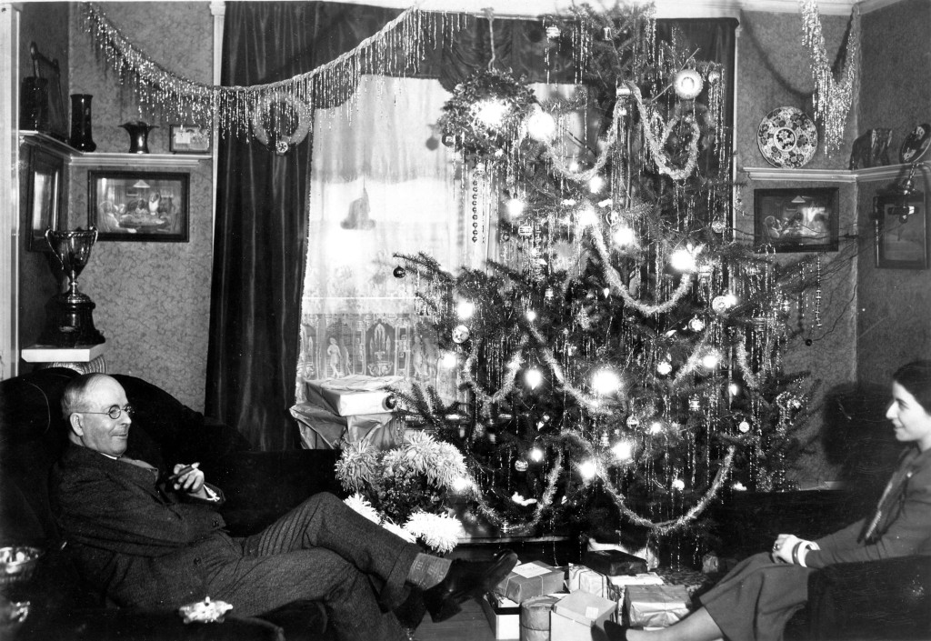 L.D. Taylor and Katherine Federici Sitting in Granville Mansion living room at Christmas, 1930s. Photo via Vancouver Archives.