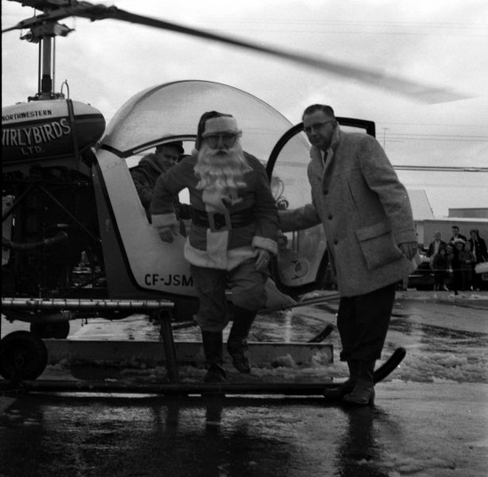 Santa Arrives at Dell Shopping Mall in Whalley by Helicopter, Dec. 17, 1964. Photo via Surrey Archives.