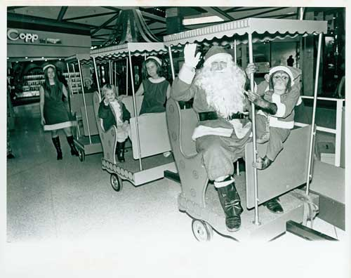 Santa and Chimp at Park Royal Shopping Centre, 1960s. Photo via West Vancouver Archives.