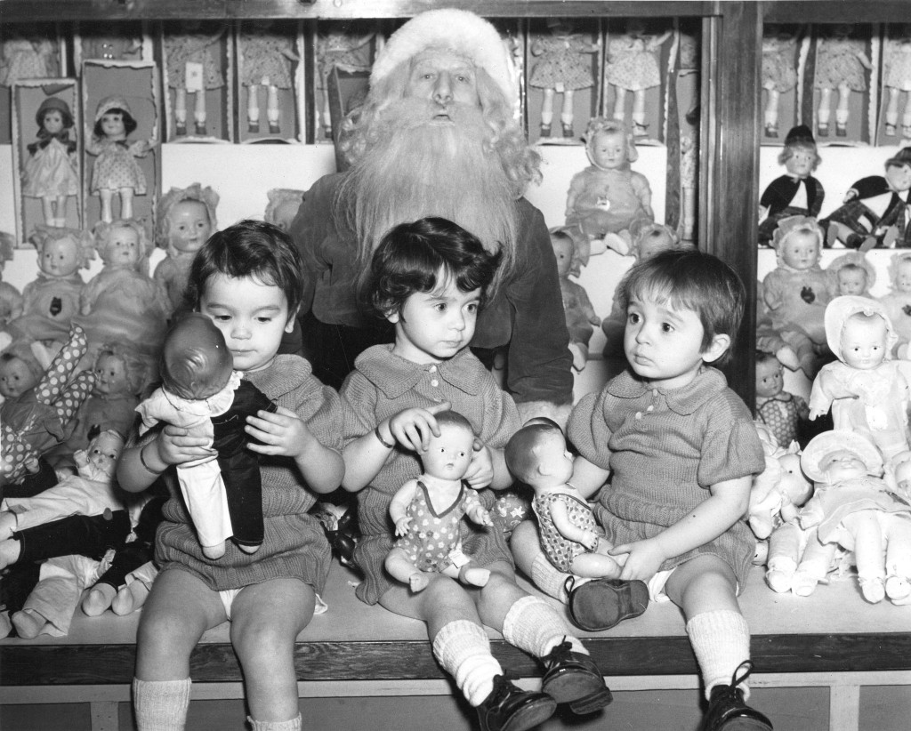 The Case triplets visit Santa, 1939. Photo via Vancouver Archives.