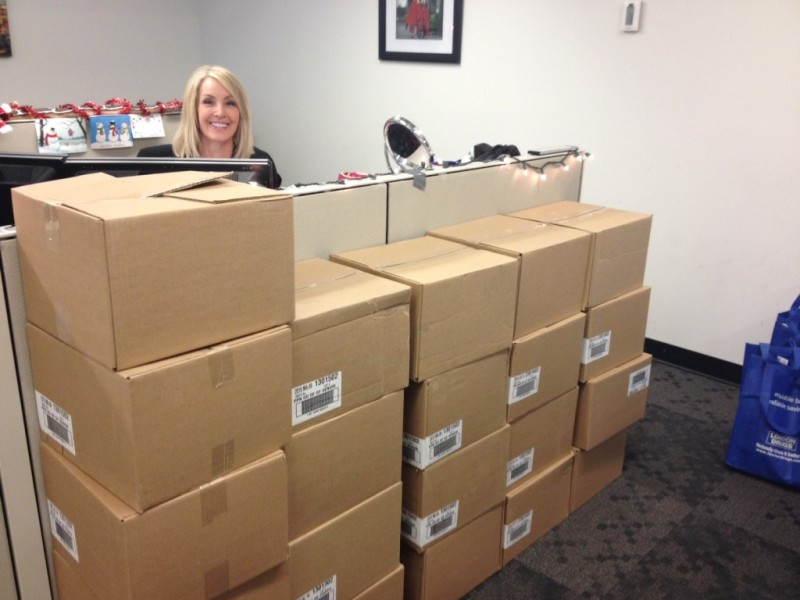 The giant pile of boxes of donated food, with Lynda peeking out.