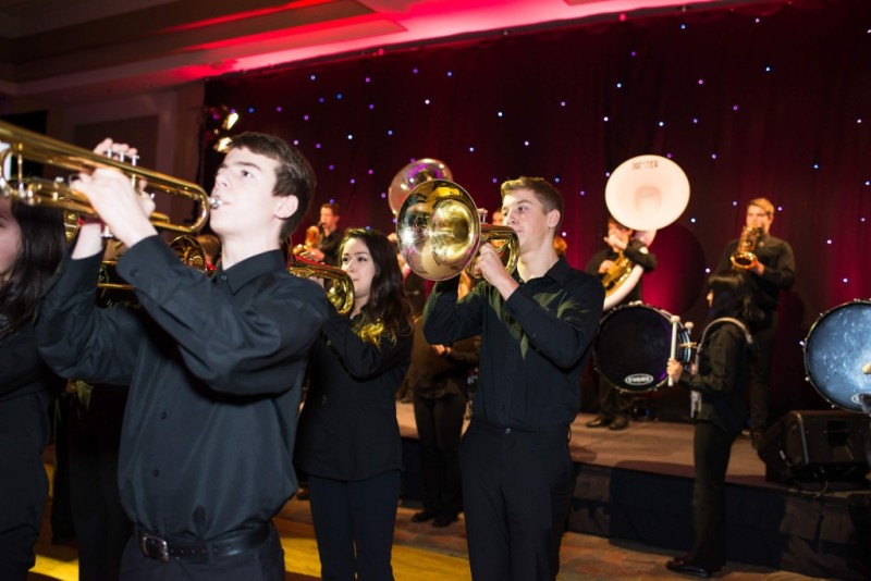 The inaugural Gift of Love Gala kicked off with the MEI Screaming Eagles – a high-spirited 80-musician marching band from Abbotsford .