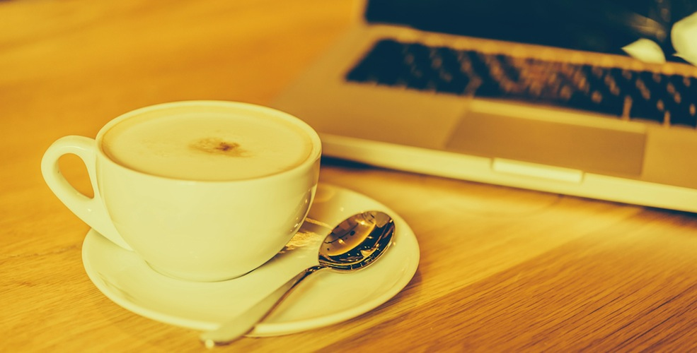 Coffee and laptop/Shutterstock