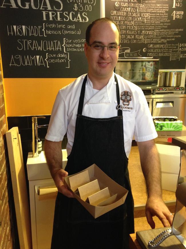 Fhernando Llanas, holding Tacomio's eco-friendly custom-designed taco take-out box (Lindsay William-Ross/Vancity Buzz)