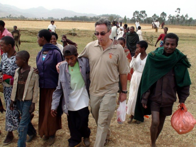 Gary and Tesfaye walking to village