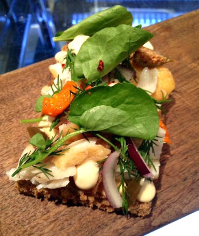 Smoked sablefish, caper berries, red onion, mustard aioli Toast at Bel Café (Photo via Bel Café/Facebook)