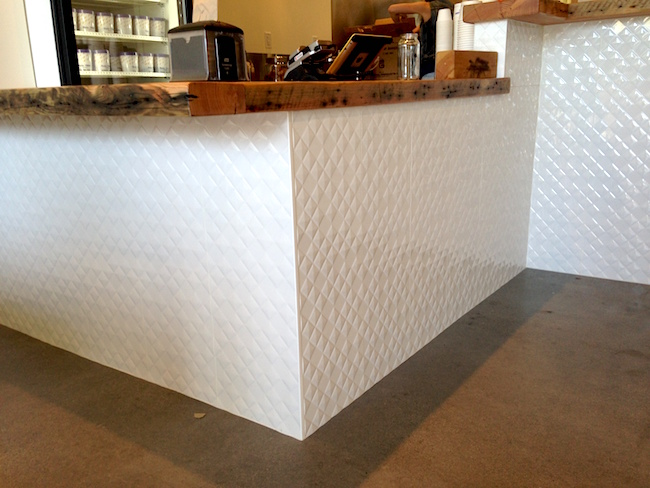 The counter is topped with reclaimed wood and the tile meant to evoke a cone's pattern (Lindsay William-Ross/Vancity Buzz)