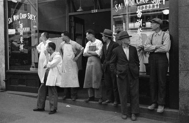 Men on street in front of Sai Woo Chop Suey House at 158 East Pender Street  (Photo by  James Crookall via Vancouver Archives)