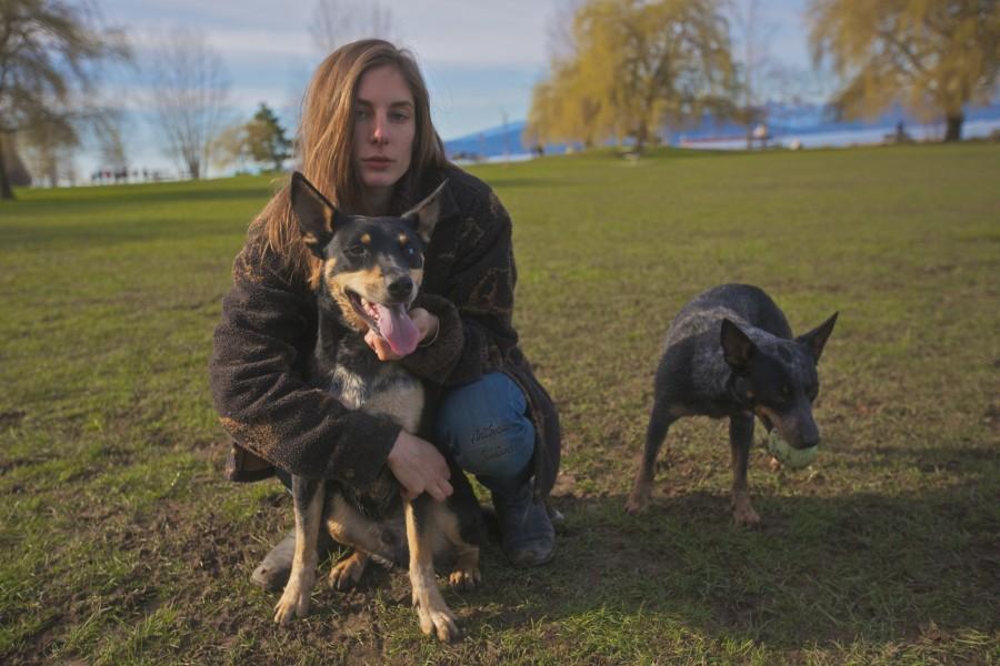 Dria with Marcel a Blue Healer Beau a Husky Rottweiler Shepherd