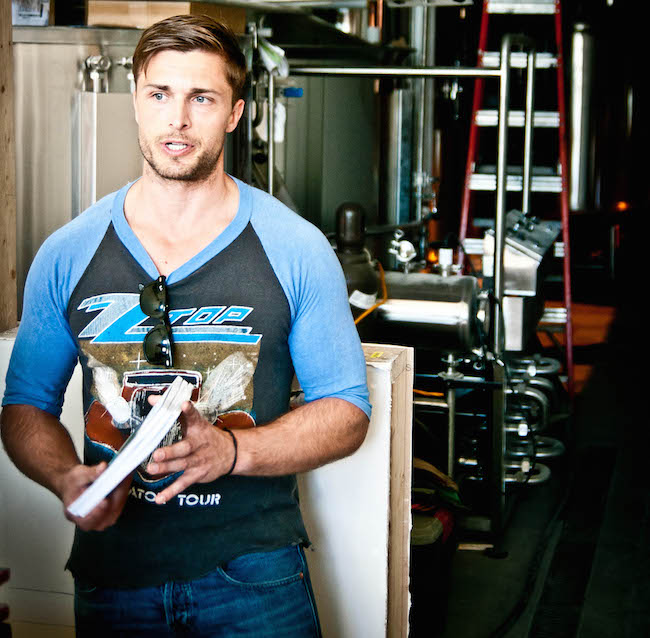 Kyle Nixon stands in front of the tanks at his new BNA Brew Co. in downtown Kelowna (Jonny Healy)