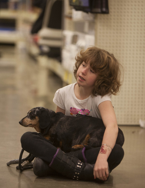 Volunteer Josilynn Dahl  cuddles with Rosy (a Dachsund cross) at The Petsmart Charities of Canada National Adoption Week event (Greg Fulmes photo).