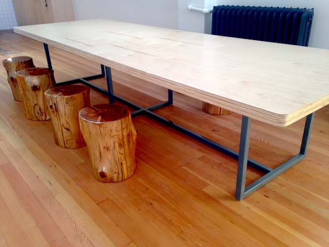 Seating options include this long table with tree stump stools (Lindsay William-Ross/Vancity Buzz)