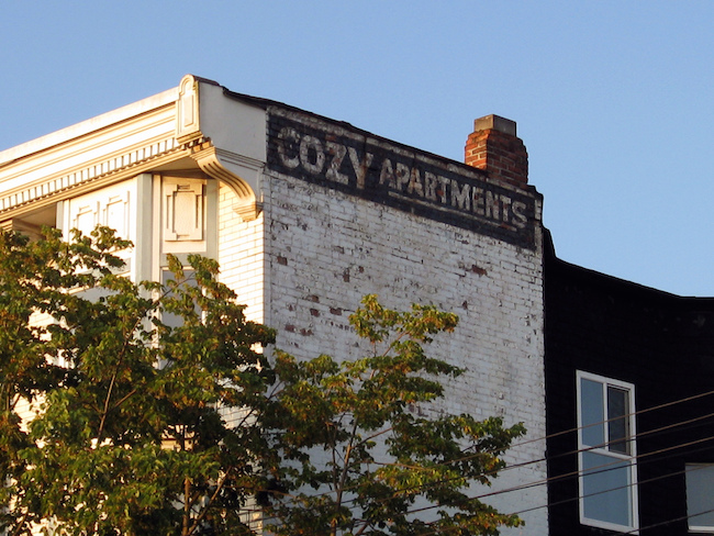 Cozy Apartments ghost sign, seen on this Commercial Drive building in 2008 (Ruth Hartnup/Flickr)