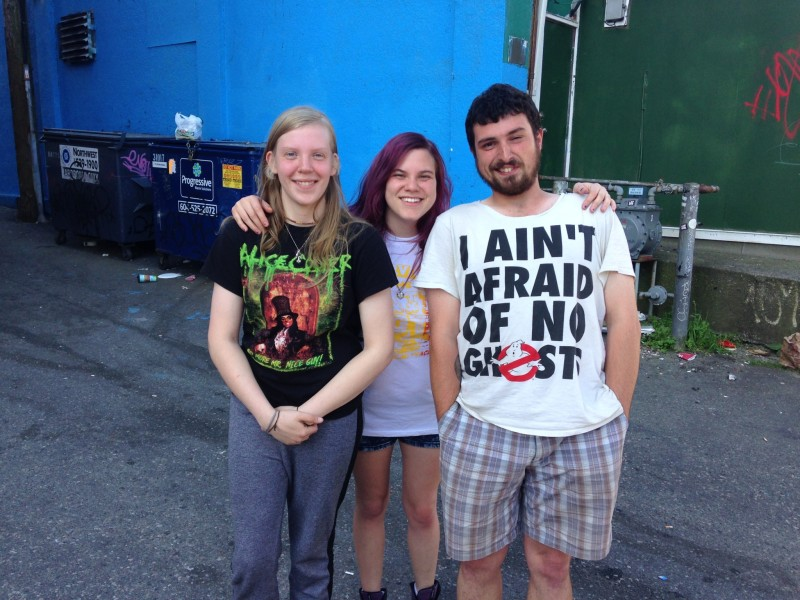 From left to right: Charlotte, Shoni-qua and Kevin had started waiting in line at 1:30 a.m./Photo: Lauren Sundstrom