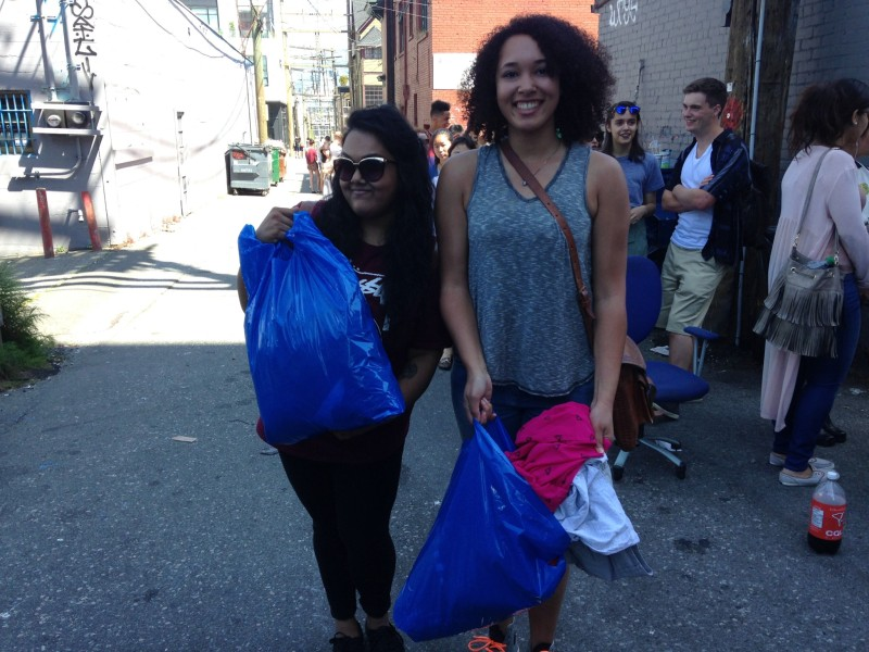 Christine Singh, left, and Alicia George, right, show off their goods/ Photo: Lauren Sundstrom