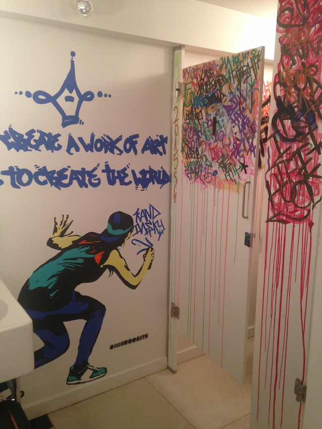 Custom graffiti-inspired artwork in the washrooms adds an unexpected edgy burst of colour to Bauhaus (Lindsay William-Ross/Vancity Buzz)