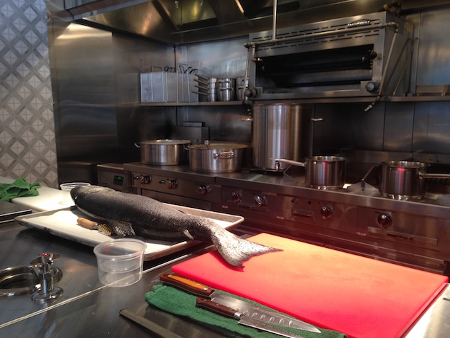 A fish awaits being broken down in the open kitchen (Lindsay William-Ross/Vancity Buzz)