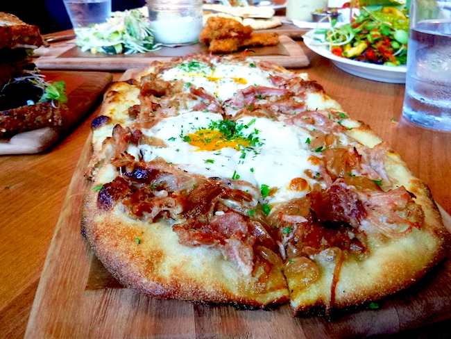 Flatbread pizza with pulled pork belly and soft eggs (Lindsay William-Ross/Vancity Buzz)