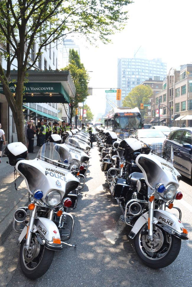 Police escort outside the Fairmont Hotel.