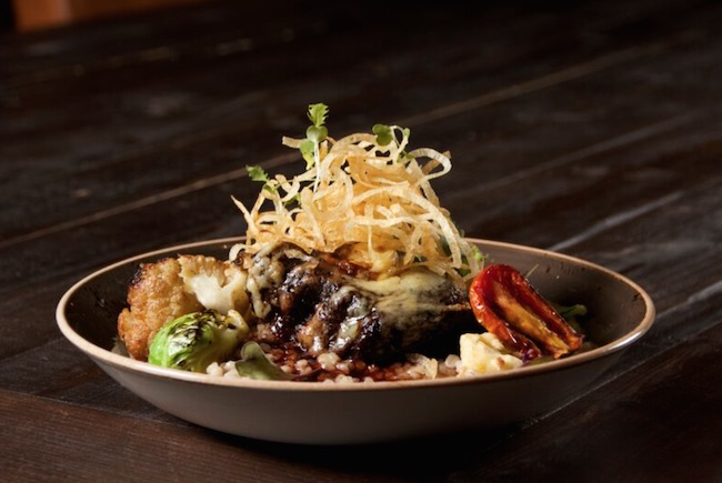 Boneless Beef Short Rib: roasted cauliflower, broccolini, Alberta barley risotto, blue cheese, chive, natural jus - $19 (Photo courtesy Village Bistro)