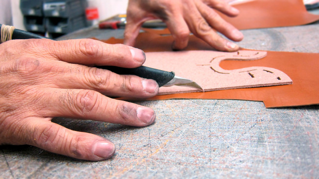 Hand cutting leather (Photo by Caroline Gault, Poppy Barley Inc.)