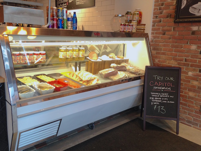 The deli case at Dunn's. It has no cheese! Customers will find it stocked each day with delicious options (Lindsay William-Ross/Vancity Buzz)