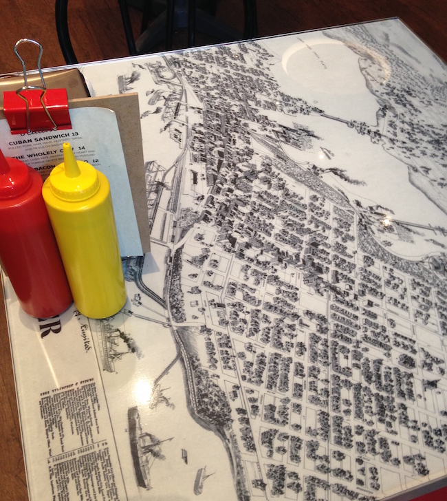 Table tops feature vintage maps and images of Montreal and Vancouver (Lindsay William-Ross/Vancity Buzz)