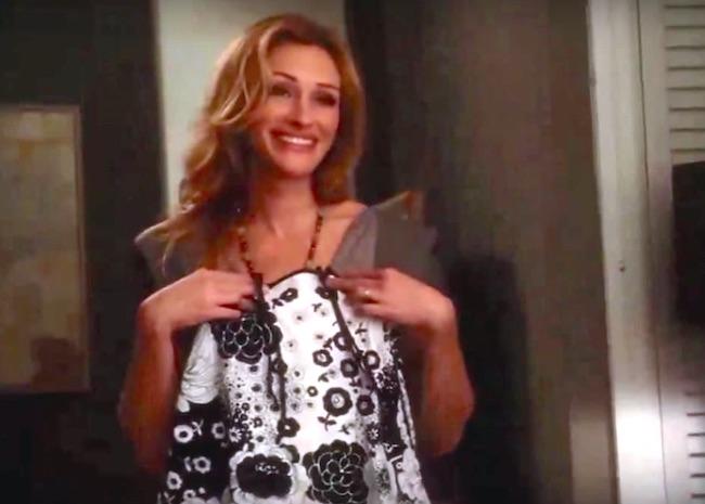 "Julia Roberts holds up a Redfish Kids dress in ""Eat Pray Love"" (Screenshot)"