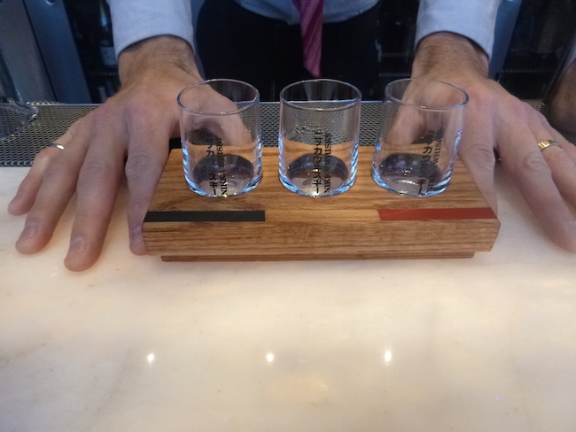 Cooke presents the board and glasses for the Nikka Whisky tasting flight (Lindsay William-Ross/Vancity Buzz)