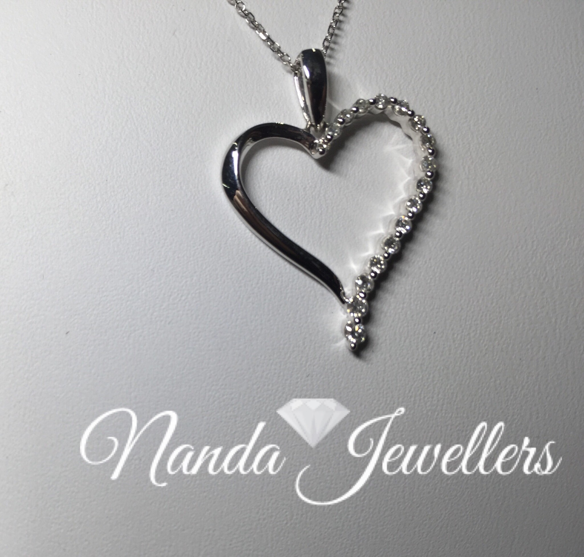 Diamond heart pendant/Nanda Jewellers