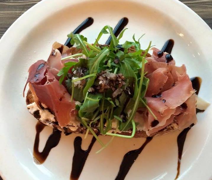 Prosciutto, house-made ricotta, and arugula on toast (Prado Cafe/Facebook)