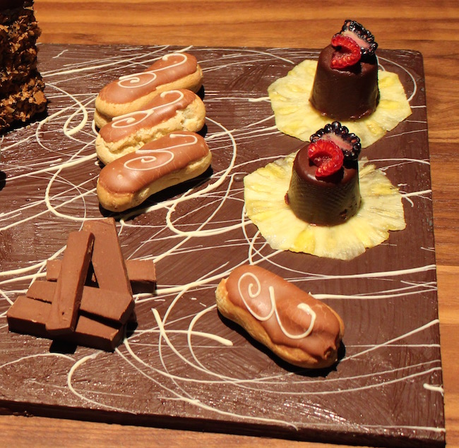 Treats like eclairs and fudge are presented on chocolate-painted boards (Lindsay William-Ross/Vancity Buzz)