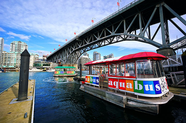 Aquabus Granville Island stop and Granville Island Bridge (Totororo.Roro/Flickr)