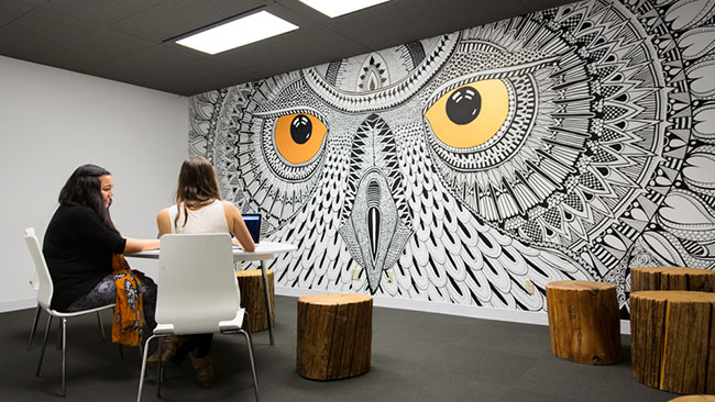 Each meeting room in the new Hootsuite office has been named after a different owl based on their respective sizes. Four rooms have also been adorned with murals. (Hootsuite)