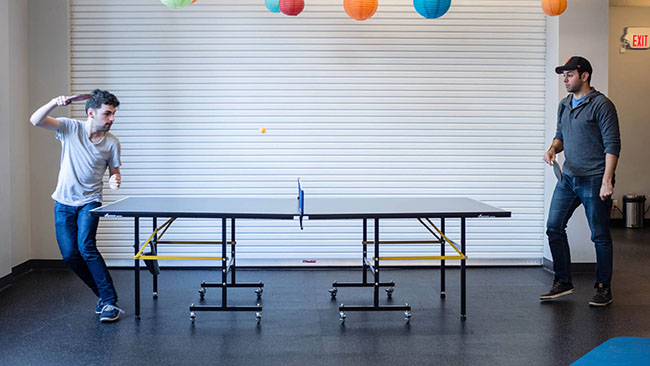Mobify employees playing ping pong (Mobify)