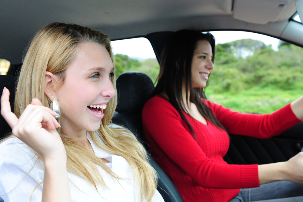 Singing in car / Shutterstock