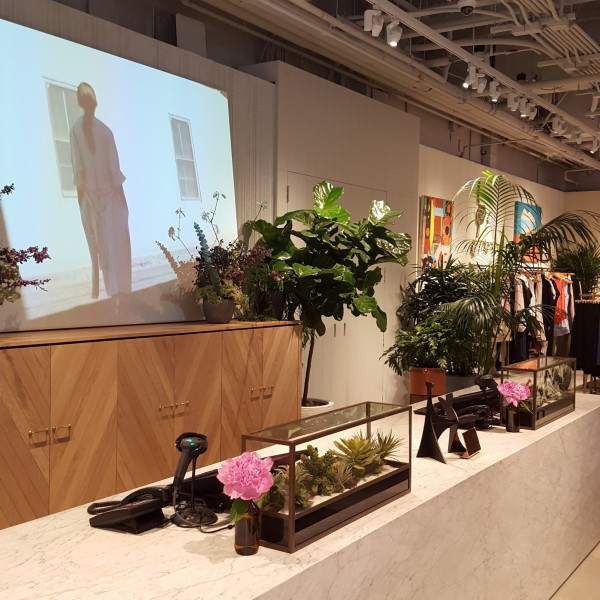 Succulents adorn the sales counter. Aritzia - Robson & Thurlow Launch