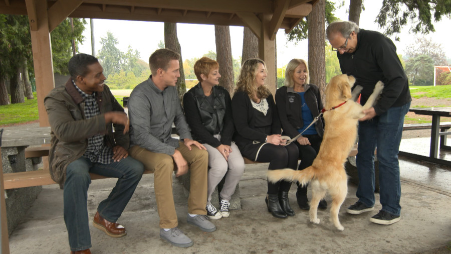 Rocky and shelter staff introduce Jessa to adopters Roberta and Randy Andrus.