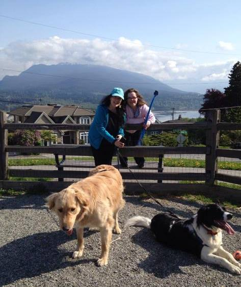 Eileen with her niece and two dogs, a big mutt named Dodger and a Stabbyhoun named O.D. (submitted).